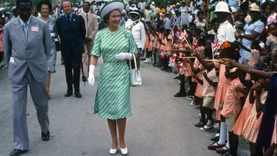 Queen Elizabeth ll is greeted by the public during a walkabout in Barbados in 1977.