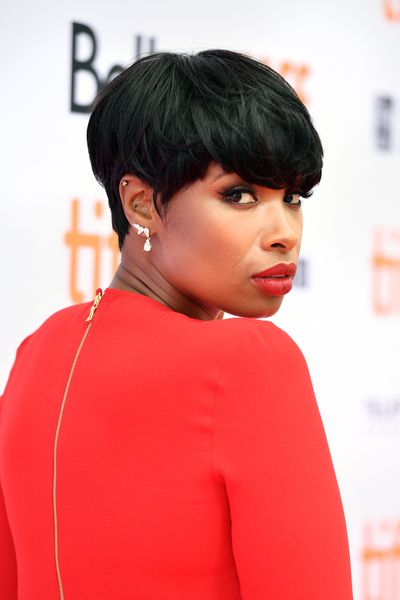 Singer Jennifer Hudson in orange-red. Very right.