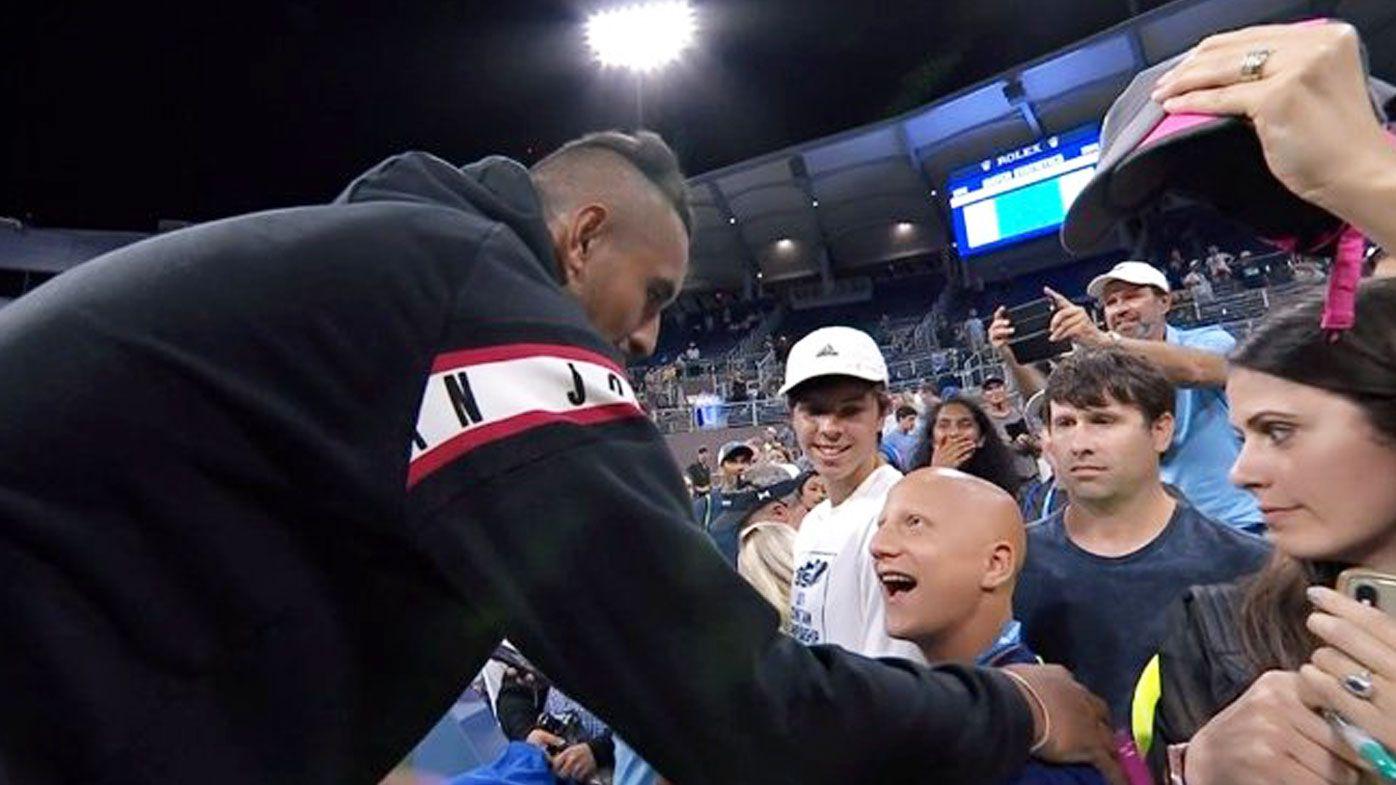 Nick Kyrgios meets a fan