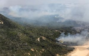 Fraser Island bushfire downgraded but threat still remains