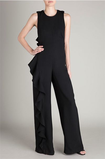 "Black tie rule breaker<br /> Yves Saint Laurent broke the rules with the Le Smoking tuxedo for women but today we suggest taking things further in a dramatic jumpsuit. Make sure to elevate your accessories and hair to show that you know what you're doing.<br /> <br /> <a href=""http://www.biancaspender.com/shop/jumpsuits/163503.0999/BLACK-CREPE-MONTMATRE-JUMPSUIT.html"" target=""_blank"">Bianca Spender</a> Black Crepe Montmatre jumpsuit, $825"
