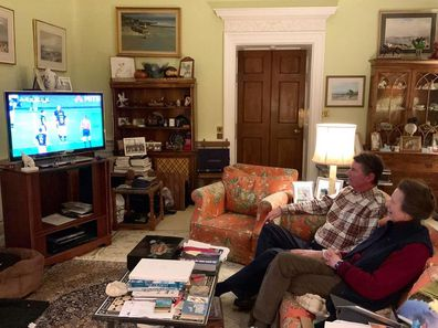 Princess Anne watches rugby in her lounge room.