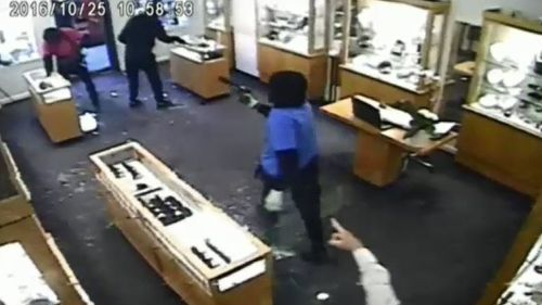 CCTV shows the masked offenders in the Toorak Road jewellery store. (9NEWS)