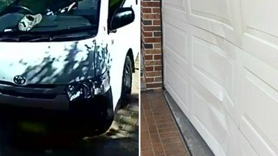 Driver smashes into garage door, delivers parcel