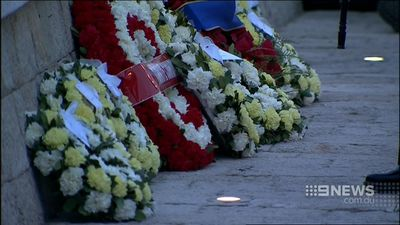 Mr Abbott laid a wreath in honour of the fallen soldiers. (9NEWS)
