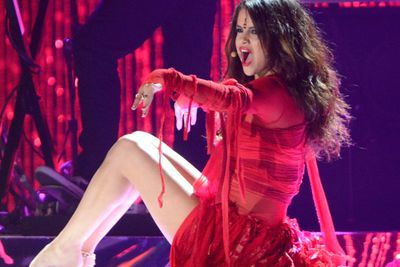 Selena stepped up the sex factor in her live performances, shown here at the MTV Movie Awards in a ripped red dress.