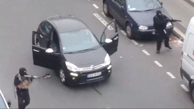 Witnesses have captured the dramatic moment heavily-armed gunmen stormed the offices of Paris satirical magazine Charlie Hebdo, killing 12 people and injuring 10 others.<br><br>Click through the gallery to see pictures taken from the scene of the terror attack.