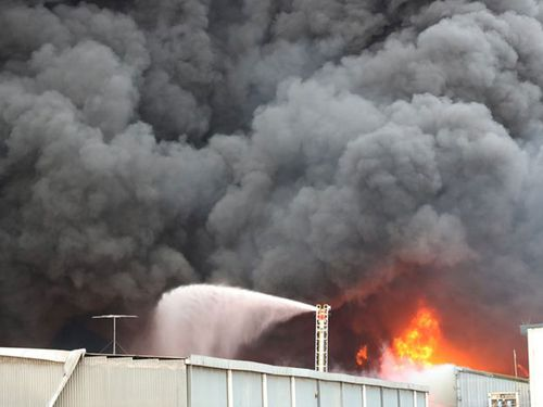 A toxic inferno has closed schools and businesses as a warehouse that caught fire in Melbourne's suburbs sparked major health fears.