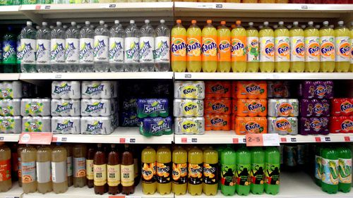 Manufacturers in the UK must pay a levy on drinks with a sugar content above five grams per 100mL – and a higher one on those containing more than eight grams. (AAP)