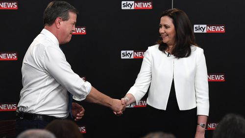 Queensland Premier Annastacia Palaszczuk shakes hands with the Leader of the Opposition Tim Nicholls during 'The People's Forum' leaders debate at the Broncos Leagues Club, Brisbane. (AAP)