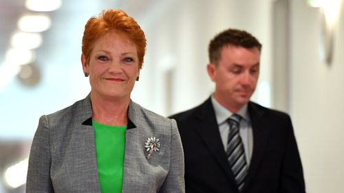 One Nation leader Senator Pauline Hanson and advisor James Ashby arrive at a press conference at Parliament House in Canberra. (AAP)