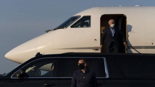 Joe Biden disembarking from a plane in his hometown of Wilmington, Delaware.