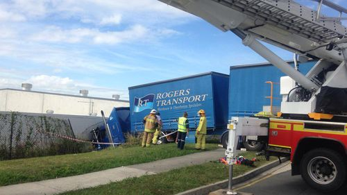 The runaway truck slammed into the warehouse wall in Brisbane. (9NEWS)