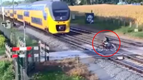 Dutch cyclist almost hit by speeding train