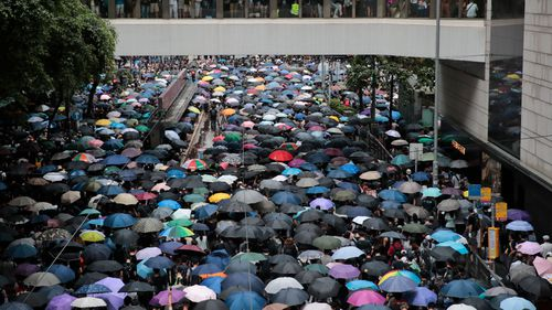 Millions of pro-democracy protesters march in central Hong Kong.