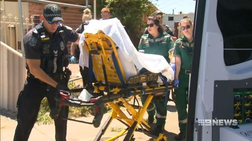 The 33-year-old man was taken away in a stretcher surrounded by police.