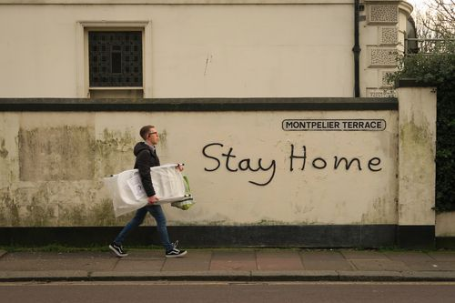 """""""Stay home"""" is graffitied on a wall in Brighton on March 17, 2020 in Brighton, England. Boris Johnson held the first of his public daily briefing on the Coronavirus outbreak yesterday and told the public to avoid theatres, going to the pub and work from home where possible."""