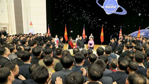 North Korean leader Kim Jong-Un (C) giving a speech during a party for scientists who contributed to the launch of the earth observation satellite Kwangmyong in Pyongyang
