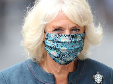 Camilla, Duchess of Cornwall wears a mask with a feather design on July 28, 2020 in London, England