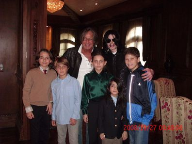 Singer Michael Jackson (R) poses with real estate developer Mohamed Hadid (L), Hadid's children and Jackson's children Michael Joseph Jr., Paris Michael Katherine and Prince Michael II on November 27, 2008 at the Jackson Holmby Hills residence in Westwood, California.