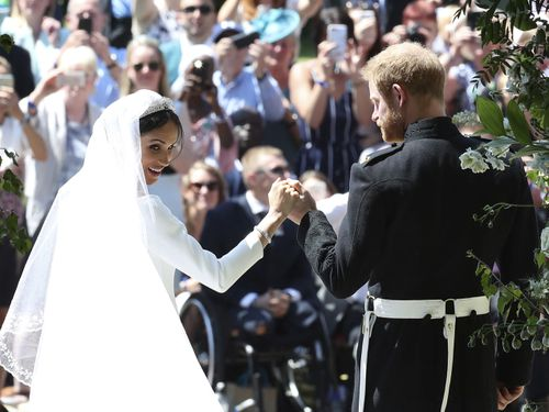The happy couple left St George's Chapel to a massive roar from the waiting crowd. (AAP)
