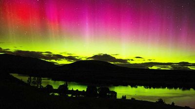 """<p>A severe geomagnetic storm created a stunning and rare light show in the skies above NSW and Western Australia on Wednesday.</p><p> The lights, aurora australis, are often visible from New Zealand and Tasmania, however, watching rights were extended to the two mainland Australian states around 1am yesterday morning. </p><p> Those lucky enough to be awake flocked to social media to document the natural phenomena, also known as the Southern Lights, which painted the dark sky an orb-like spectrum of green, purple and pink. </p><p> One Kiama, NSW man recorded the stunning sight from his backyard as it unfolded, later <a href="""" https://www.youtube.com/watch?v=aq2yb2-gz-E """"> posting the video online</a> keen to share his spoils. </p><p> """"This is insane … oh my God, look at that,"""" the ecstatic night-watcher narrated the clip. </p><p> The rare event was also witnessed in the Northern Hemisphere over parts of the US and Europe, where it is called aurora borealis. </p><p> Both auroras were sparked by a particularly strong solar storm that sent charged solar particles hurtling towards earth, according to the Australia Bureau of Meteorology. </p><p> """"These collisions cause the neutral atoms to fluoresce, emitting light at many different wavelengths,"""" a spokesman told <a href="""" http://www.abc.net.au/news/2015-03-18/aurora-australis-captured-on-social-media/6327840 """"> ABC News</a>. </p><p> """"The most common aurora colours are red and green, caused by the fluorescence of oxygen atoms, while nitrogen atoms can throw bluish-purple lights into the mix."""" <i>Photo of Lake Ruataniwha, NZ by RDVB Photography</i></p>"""
