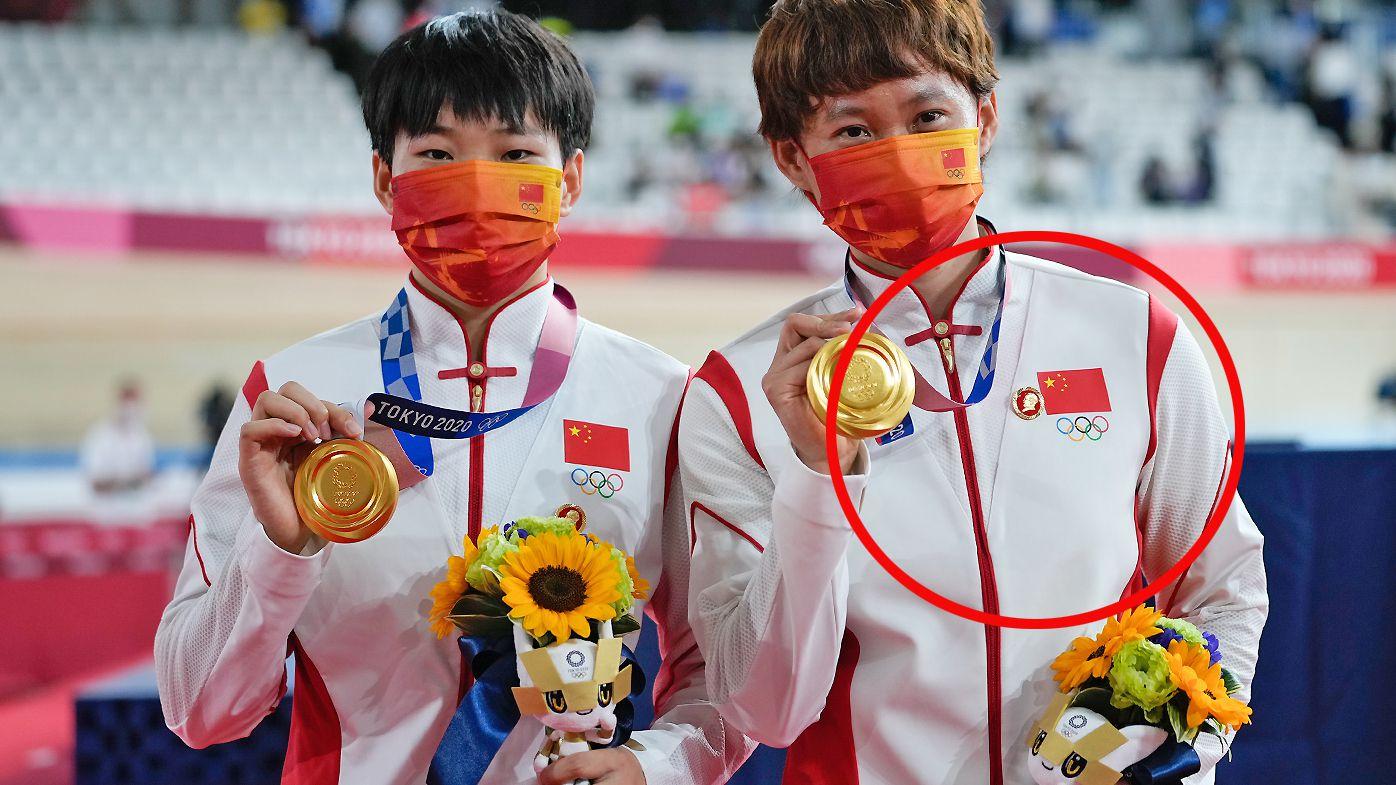 Gold medalists Zhong Tianshi and Bao Shanju of Team China wearing a Mao Tse Tung badge