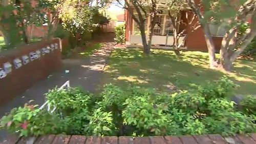 The woman ran into a front yard in Ashfield last night when a man placed a cable bike lock around her neck. (9NEWS)