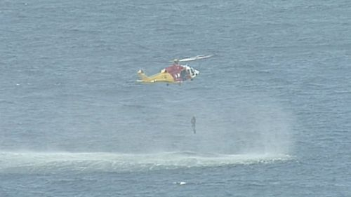 The two divers were lifted out of the water by helicopter after three hours missing.