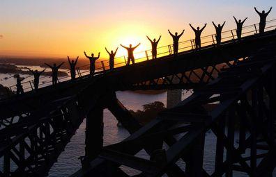 BridgeClimb Sydney -- climbers scaling the Sydney Harbour Bridge at dawn