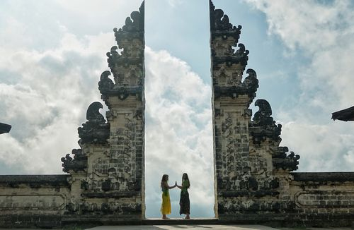 Tourists pose at the gate of heaven at Lempuyang temple in Bali.