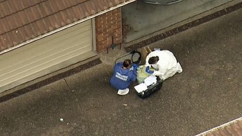 Police are investigating the woman's death, after the body was found in the unit block driveway