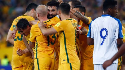 Socceroos celebrate a goal. (AAP)