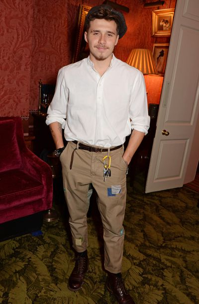 Brooklyn Beckham attends his mum Victoria Beckham's the 10th anniversary party of her fashion label.