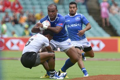 Faalemiga Selesele of Samoa is tackled by Amenoni Nasilasila of Fiji. (AAP)