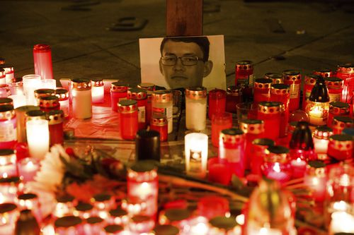 People light candles as they pay respect to the Slovak investigative reporter Jan Kuciak and his girlfriend Martina Kusnirova in Prague, Czech Republic, February 26, 2018. Investigative reporters Jan Kuciak, working for the Aktuality.sk online news portal, and his girlfriend were murdered in Slovakia this weekend, while his work was the most probable motive. Photo/Kamil Kosun (CTK via AP Images)