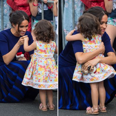 Meghan embraces a small child, 31 October 2018