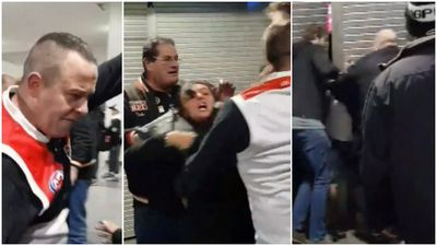 Violent brawl erupts between footy fans in front of children
