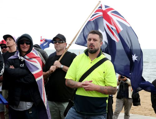 Some of the far-right protesters at Saturday's rally on St Kilda Beach in Melbourne. (AAP)