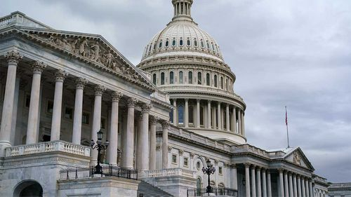 Congress has narrowly approved a stopgap measure to avoid the US defaulting on its debts.