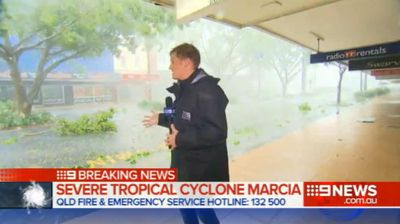 "<p _tmplitem=""1"">Channel 9 Queensland reporter Joel Dry's live cross from cyclone battered Rockhampton took a dramatic turn today, after wild winds tore free a piece of nearby roof and sent it spinning past him.</p><p _tmplitem=""1""> While updating the Brisbane newsroom from the town of Rockhampton, which is now in the direct path of the tropical cyclone, Dry was interrupted by a large sheet of metal flying off a nearby shop roof. </p><p _tmplitem=""1""> As the sheet was sent spinning along the road with a series of resounding crashes, Dry and his crew quickly pulled back into the relative safety offered by a shopfront. </p><p _tmplitem=""1""> ""I might just take shelter here,"" the ironically-named reporter can be heard telling the newsroom, almost drowned out by the sounds of the wind and rain. </p><p _tmplitem=""1""> Dry earlier tweeted photos of streets awash with water and littered with debris, leaves and branches. </p><p _tmplitem=""1""> After finishing the segment, Dry and the crew sought shelter in a nearby office building. </p><p _tmplitem=""1"">  Check out this gallery for other times the weather has turned on hapless television reporters.  </p><p _tmplitem=""1""></p>"