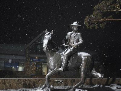 Snow setting on cattleman statue in Mount Buller, Victoria.