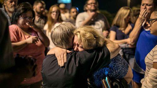 Texas Governor Greg Abbott embraces Ann Montgomery, a Sunday School teacher at the Sutherland Springs First Baptist Church.