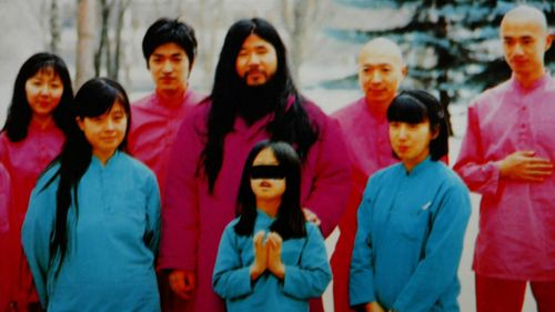 Cult leader Shoko Asahara with his family and cult members.