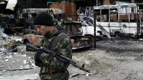 Kiev set to join EU, offers self-rule for eastern separatists