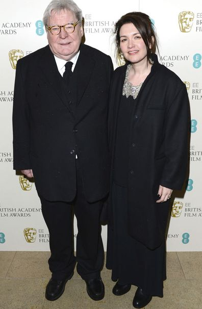 Director Alan Parker and his wife, Lisa arrive for the BAFTA Film Awards in London on Feb. 10, 2013.