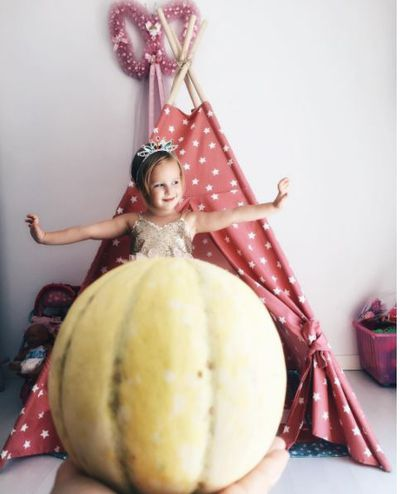<p>Ready for the ball complete with melon gown.</p>