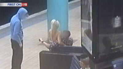 A loved-up teenage couple is distracted while a co-conspirator snatches handbag from around the pillar. (9NEWS)
