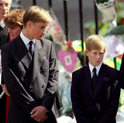 Prince William and Prince Harry stand outside Westminster Abbey at the funeral of Diana, Princess of Wales on September 6, 1997.