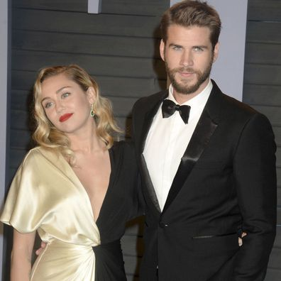 Miley Cyrus and Liam Hemsworth at Vanity Fair Oscars afterparty